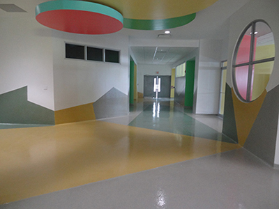 Invision-Comcorco-school-flooring-geometric-colored-hallway